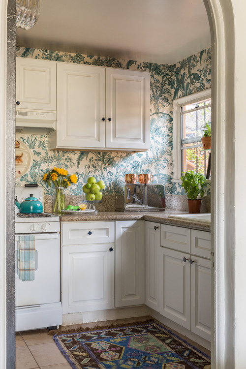 Traditional kitchen with blue and white wallpaper