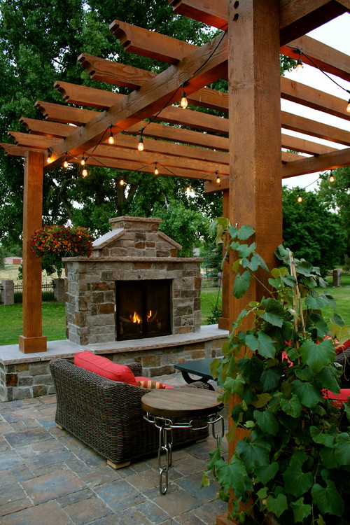 Traditional Patio with Arbor and Fireplace