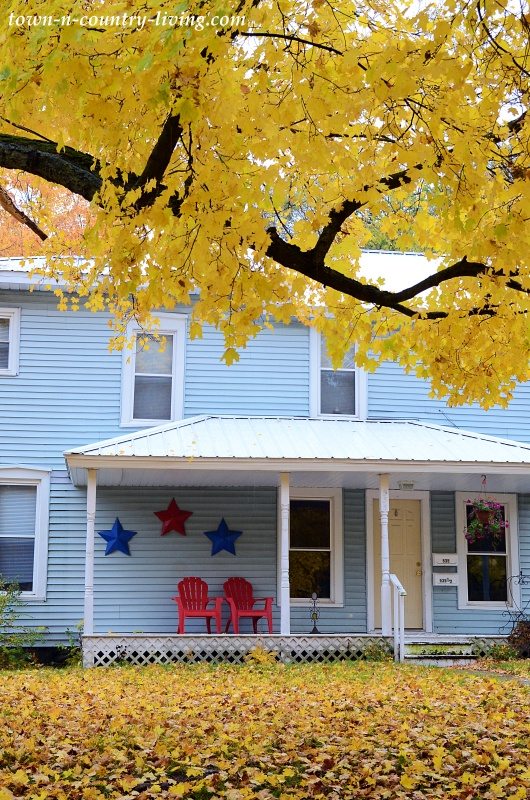 Light Blue Cottage with Red Porch Chairs