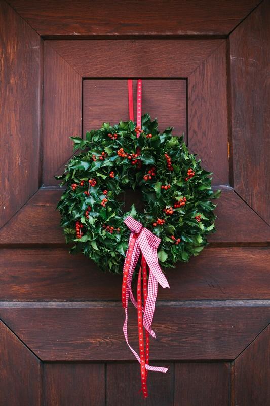 Beautiful Holly Wreath on Wooden Door