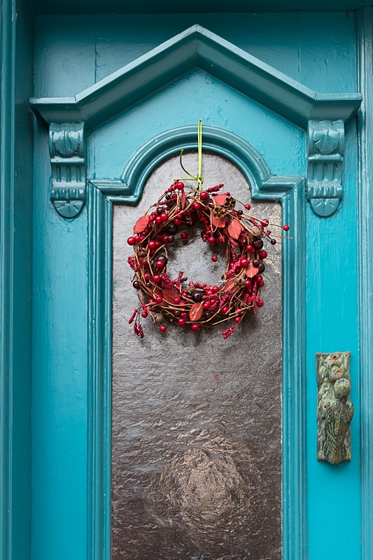 Turquoise Door with Red Christmas Wreath