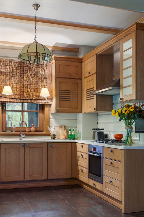 Warm Wood Cabinets in Moscow Kitchen
