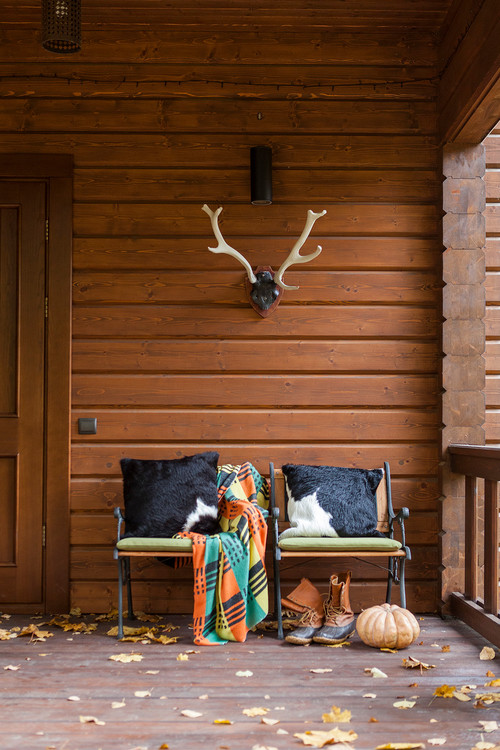 Cowhide Pillows on Front Porch Chairs