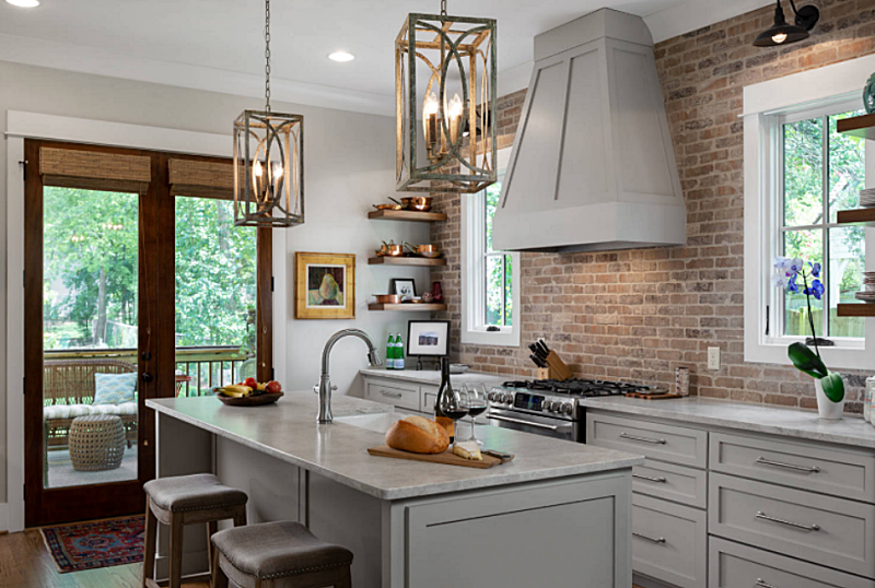 Farmhouse Style Kitchen with Brick Wall and Ample Island