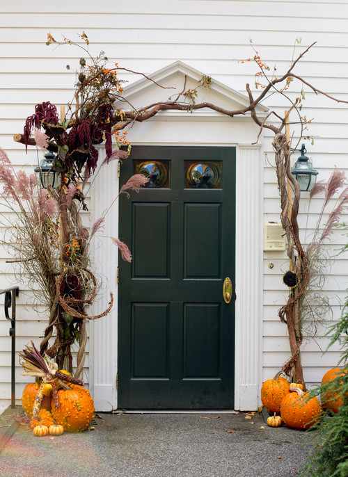 Front Door Decorated with Branches and Pumpkins for Fall