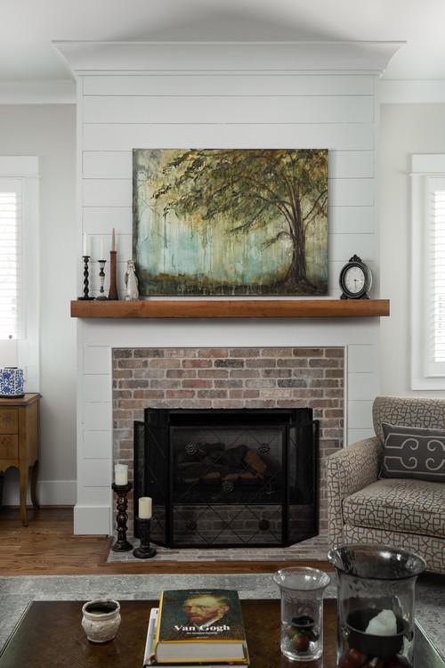 Wooden Beam creates mantel above brick surround fireplace
