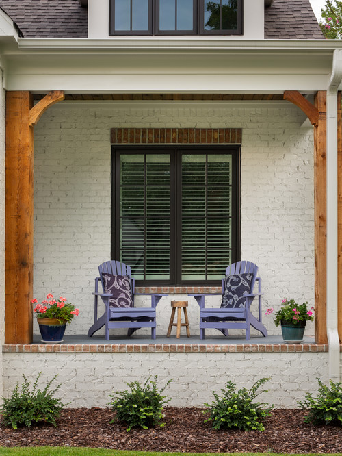 Charming White Cottage Porch with Adirondack Chairs in Birmingham, Alabama