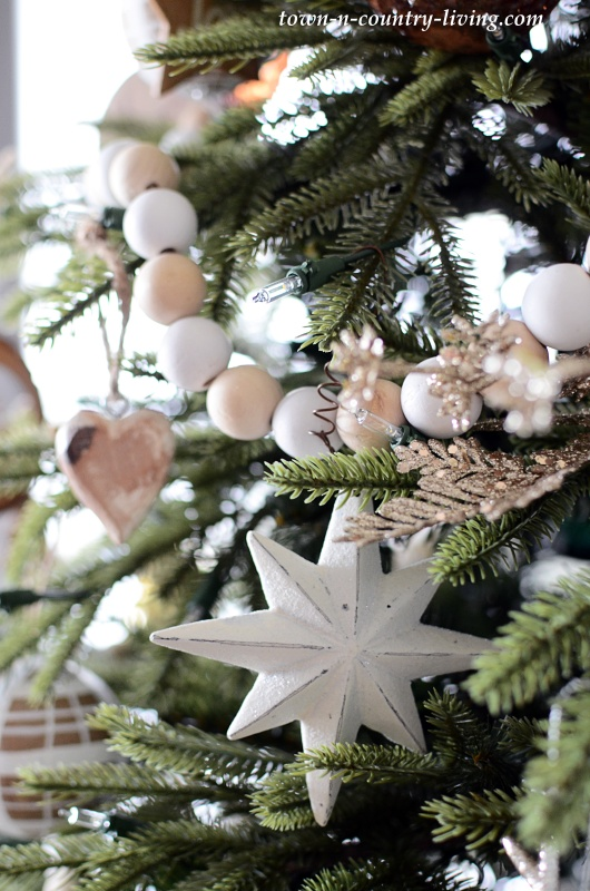 Rustic Christmas Tree with Wood Bead Garland and Nature Inspired Ornaments