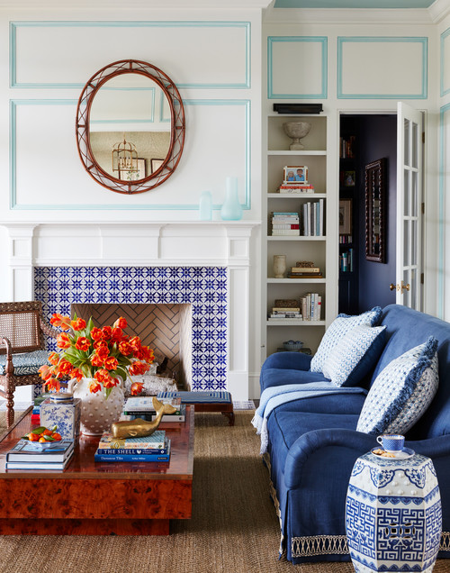 Traditional Living Room with Blue Tiled Fireplace and Blue Sofa