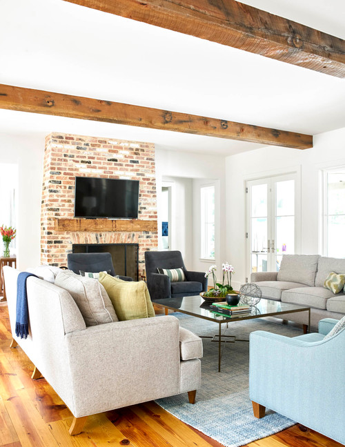 Modern Country Living Room with Brick Fireplace and Wood Ceiling Beams
