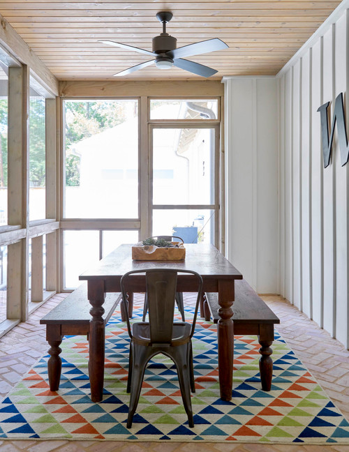 Farmhouse Style Screened In Porch with Colorful Rug