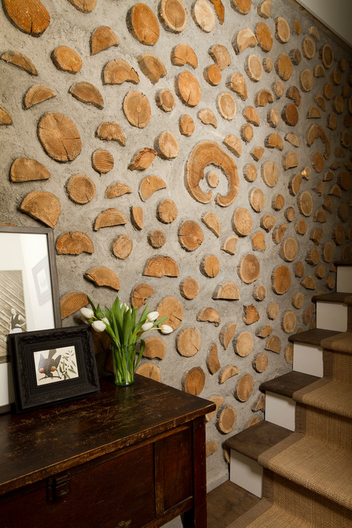 Farmhouse Staircase with Wood Slice Accents on Wall