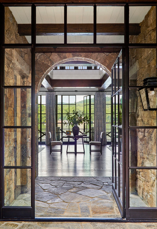 Glass and Iron Windows Meet Stone Walls