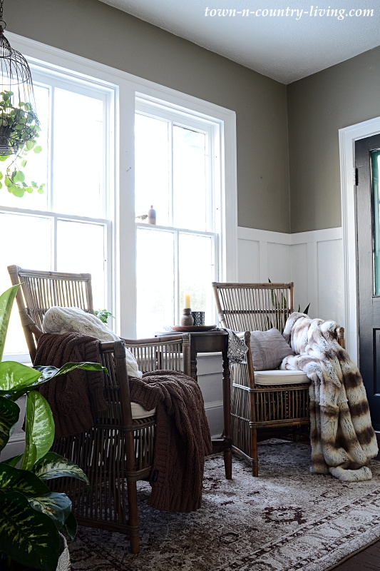 Cozy Entryway with Rattan Chairs and Faux Fur Throws