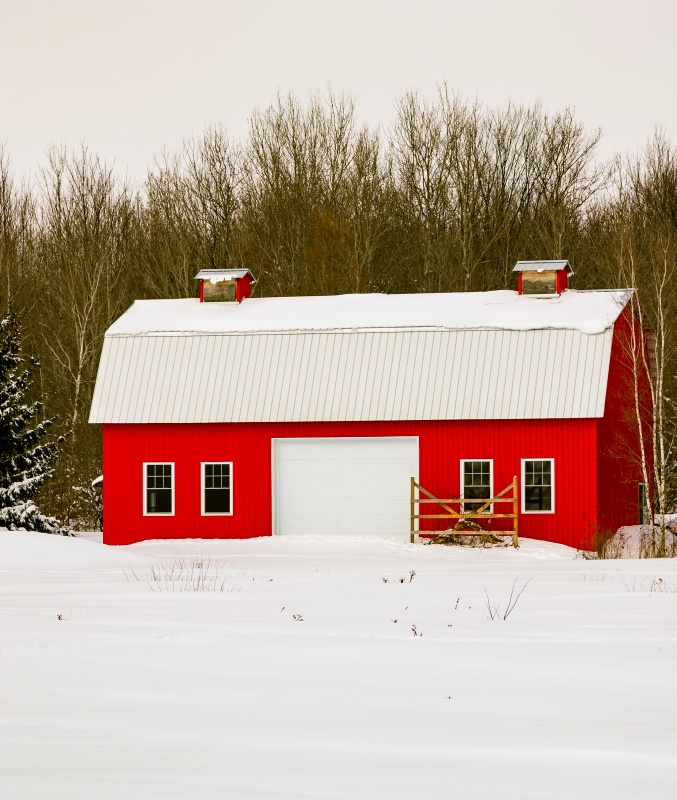 Red Barn in Forest Covered with Snow