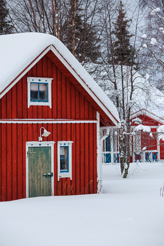 Red Finnish House and Barn in the Snow
