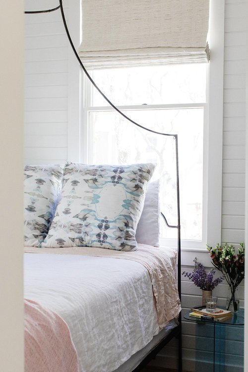 Coastal Style Bedroom with Iron Canopy Bed