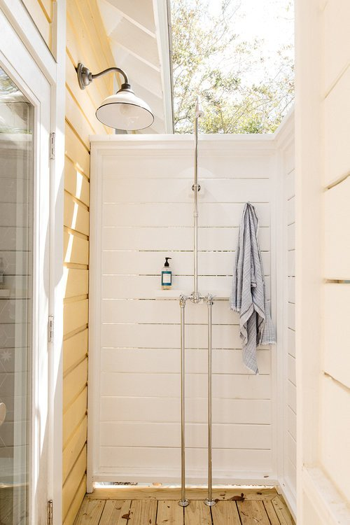 Outdoor Shower on Porch of Small Cottage