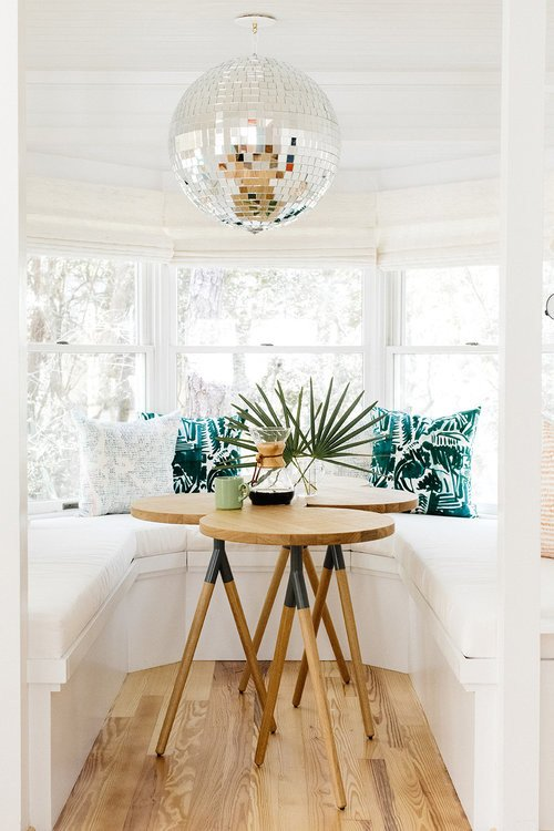 Dining Nook with Disco Ball in Beach Style Cottage
