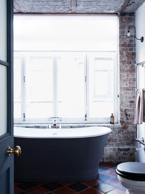 Free Standing Tub in Industrial Style Bathroom