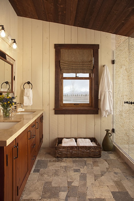 Bathroom with Wood Paneling and Natural Stone Floor