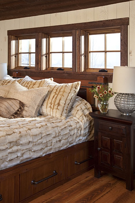 Birch Bark Bedding in a Wood Paneled Master Bedroom