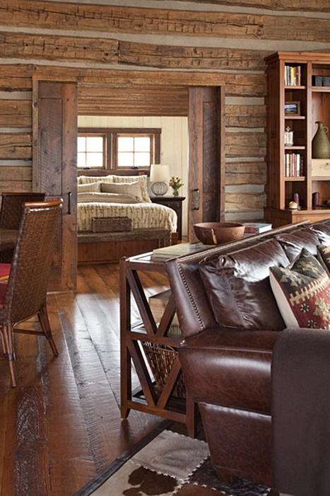 Master Bedroom in Cozy Cabin with Wood Log Walls