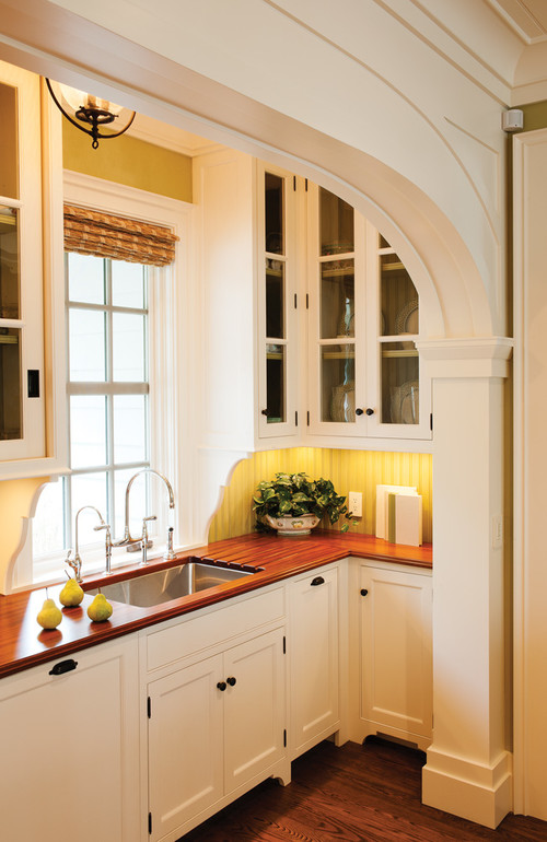 Traditional Yellow Kitchen with Glass Front Cabinets