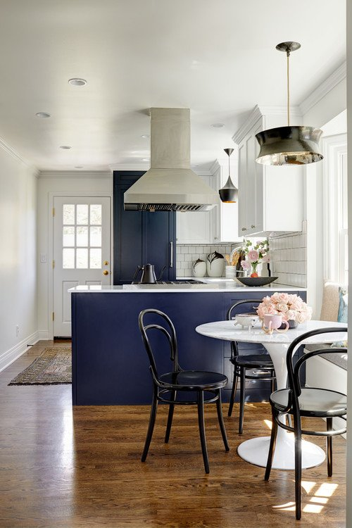 Bentwood chairs in small blue and white kitchen