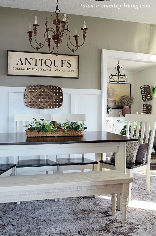 Farmhouse Style Dining Room with Antiques Sign