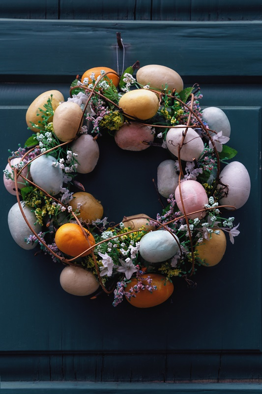 Beautiful Easter Egg Wreath on Dark Blue Door