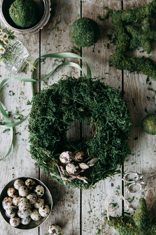 Spring wreath with quail eggs,  Compositions of moss and greenery