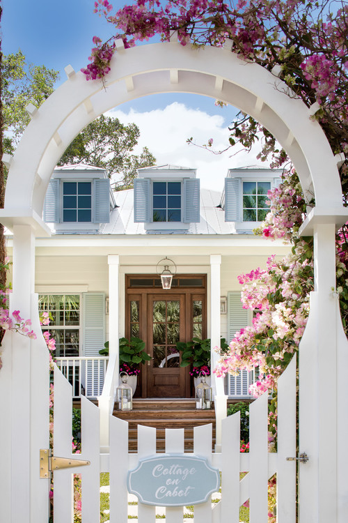 Beach Style Cottage with White Picket Fence and Arbor