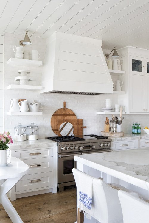 All White Kitchen with Wood Floor and Bread Boards