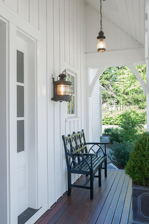 Farmhouse Front Porch with Unique Light Fixtures