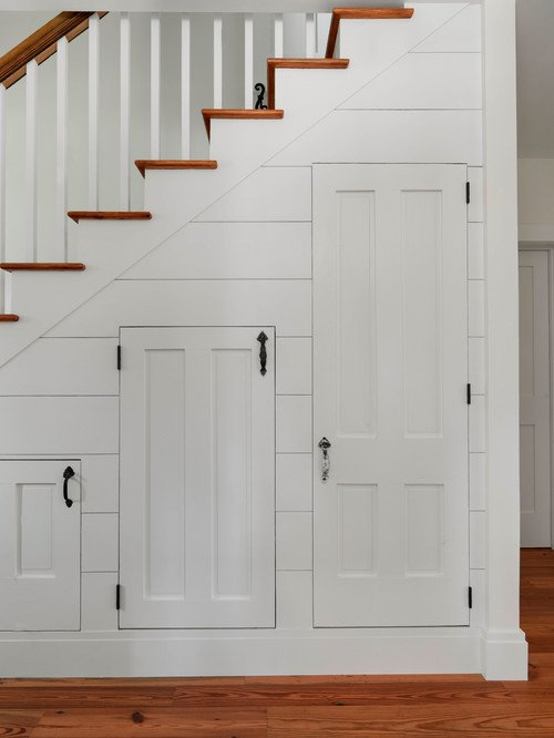 Unique Farmhouse Stairway with Doors Underneath