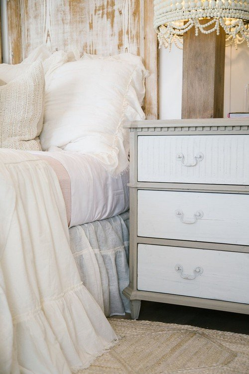 Layers of Soft White Bedding on a Shabby Chic Bed