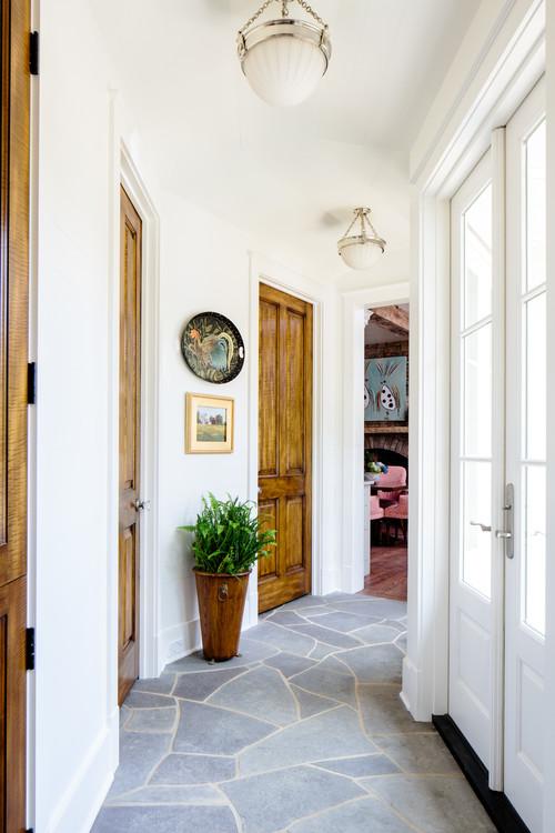 Hallway with Stone Floor and Wood Panel Doors