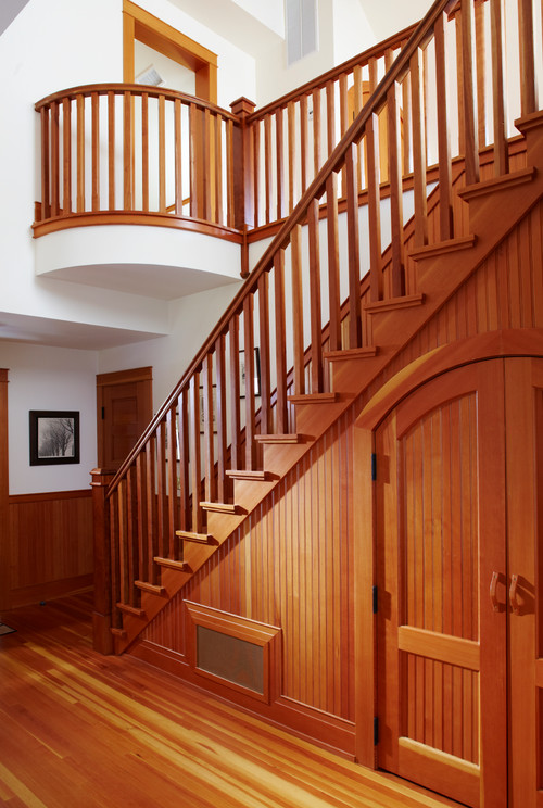 Entryway Staircase of Honey Stained Wood