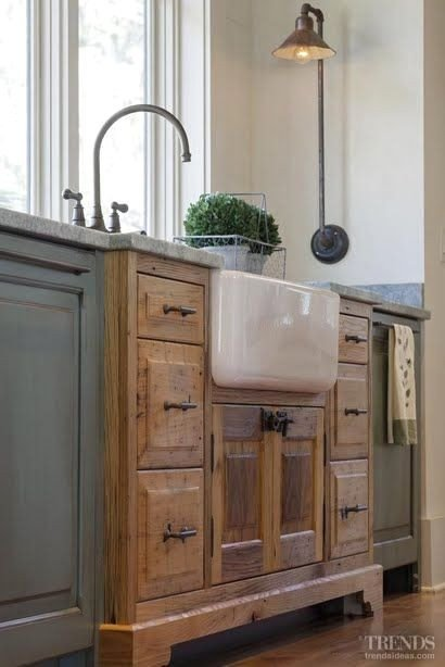 Farmhouse Sink In Kitchen with Wood and Painted Cabinets