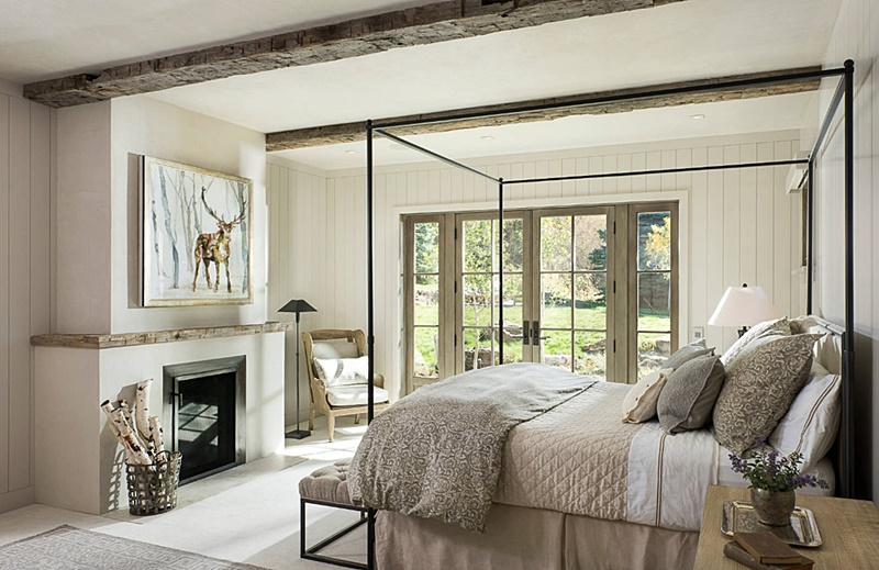 Rustic and Neutral Master Bedroom with Fireplace and Beamed Ceiling