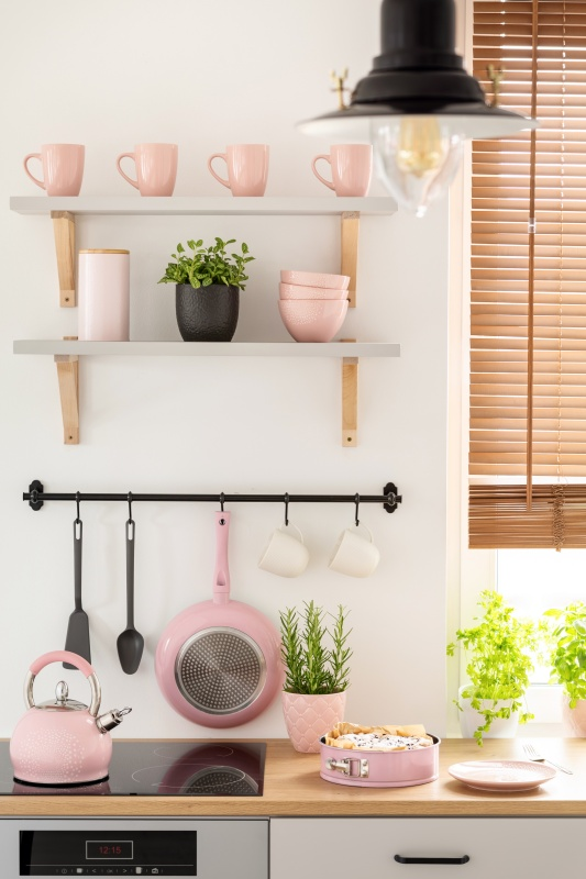 Pink Dinnerware and Pots and Pans on Display in a Contemporary Kitchen