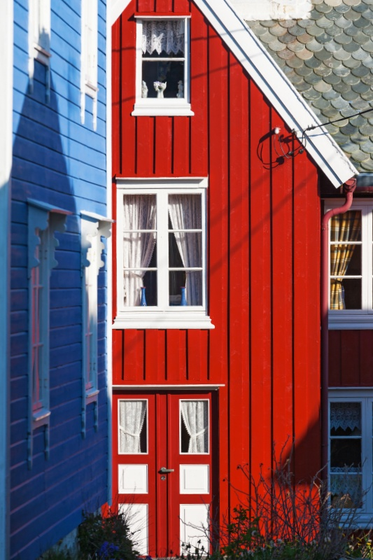 Red wooden house in an alley