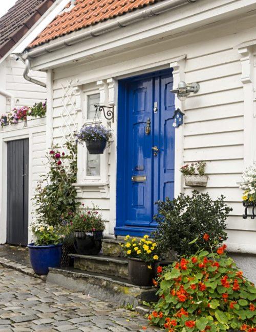 White Scandinavian House with Blue Door in Stavanger Norway