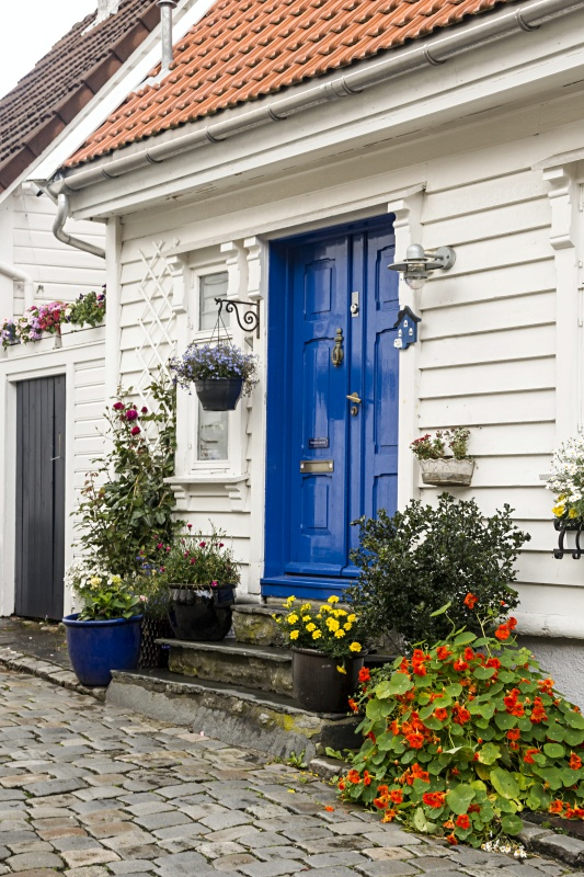White Scandinavian House with Blue Door in Stavanger Norway