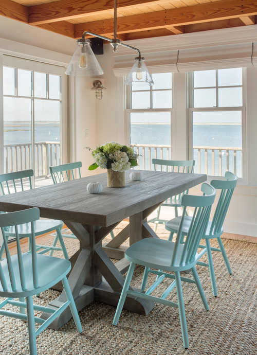 Beach Style Dining Room with Waterfront View