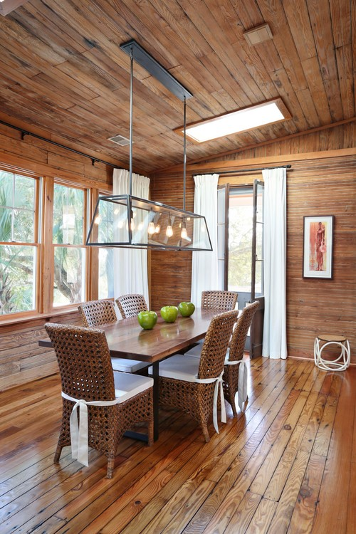 Rustic Beach House Dining Room with Wood Planked Walls