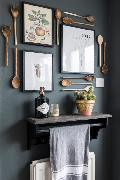 Nature Prints and Wooden Spoons Create Display on Kitchen Wall