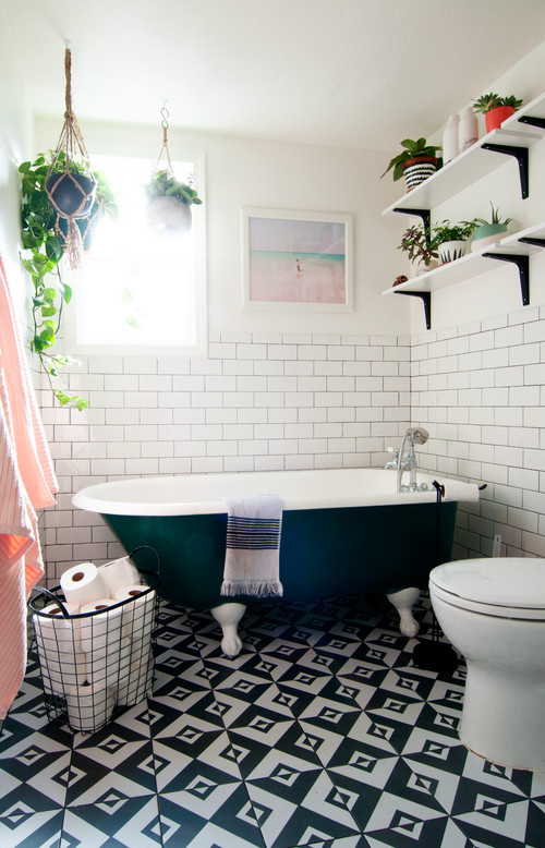 Eclectic Bathroom with Geometric Tile Floor and Claw Foot Tub