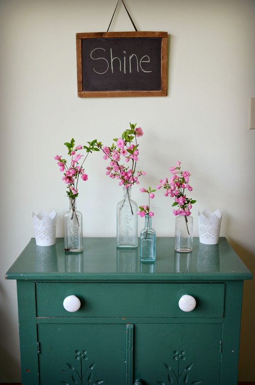 Spring Flowering Branches in Vases on Painted Dresser